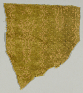Fragment with a mustard-colored ground showing a pinkish-tan pattern of highly formalized flowers, urns, and vines in vertical stripes.