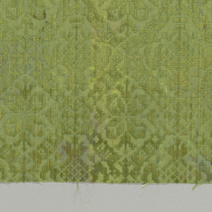 Diamond grid pattern containing quatrefoil flowers in green.