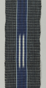 Long strip of woven cotton with a simple woven windowpane check; a wide stripe down the center is edged with light blue and has two parallel lines of white ikat.