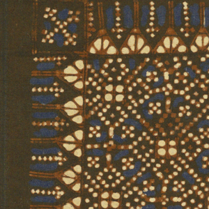 Small rectangle of cotton with two large repeats of design enclosing squares, dots, and triangles. Reserved white, rust, and blue on dark brown ground.