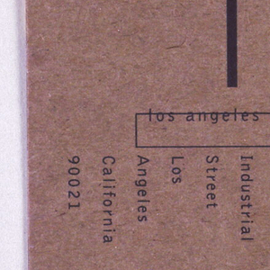 Business card for LACE (Los Angeles Contemporary Exhibitions) printed on back of cardboard recycled poster. Corporate logo at top right: LACE (in white letters superimposed on black rectangle). Additional text includes address, phone number and name of Executive Director of company. On verso, background color fades from yellow to orange. Partial large capital letters (A and D) printed in black, superimposed on color. Designed by Simon Johnston of firm, Praxis.