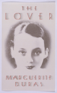 "Design for front cover of book by Marguerite Duras. Cream ground with central gray and white photographic detail of young girl's face. Text printed in red and shaded in gray; title at top and author's name at bottom. Verso: At top, label with designer's company, ""Louise Fili Ltd."" and address. Published by Pantheon Books, New York Art Director: Louise Fili. Photograph of a young woman with shadowed thin red letters: THE / LOVER / MARGUERITE / DURAS."