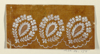A lace leaf in a wreath stands obliquely over a scalloped border. Three repeats are shown.