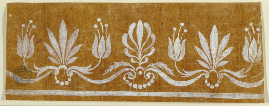 Crest border over a strip; it shows lead palmettes which are flanked by blossoms alternating with stylized palmettes.