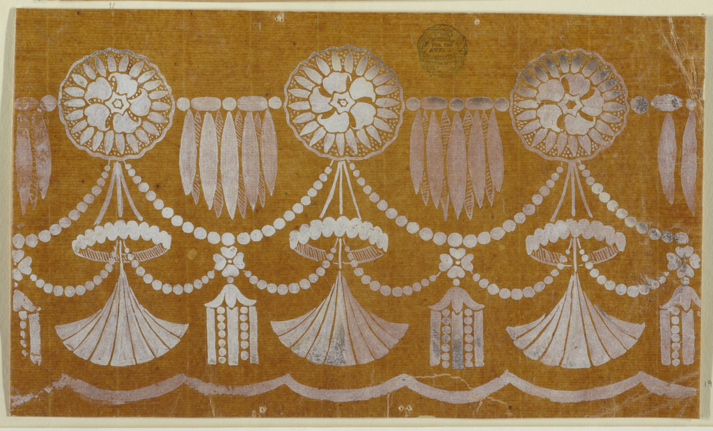 Blossom rosettes are connected by diadems with drops and by chains from which tassels are suspended. A crown and a fan are suspended at the bottom of the rosettes; chain festoons connect the supports of the fans and the tassels. An undulated stripe is at the bottom.