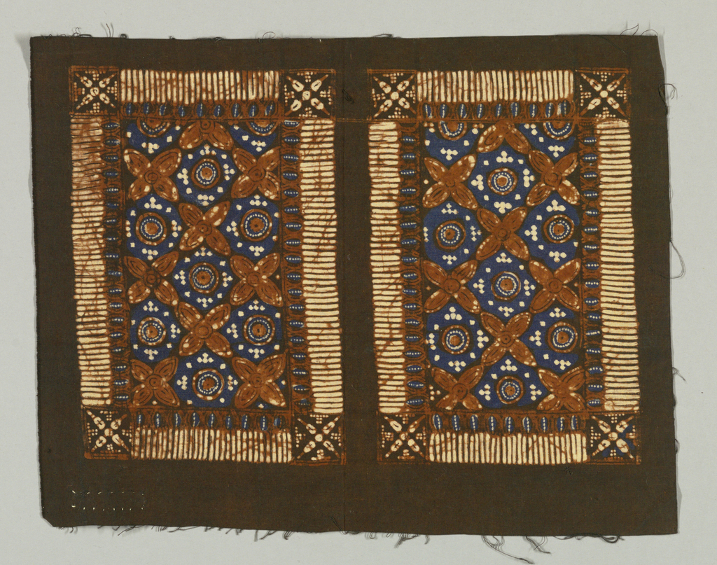 Brown cotton batik-printed with two repeats of rectangle edged with comb-like border and enclosing quatrefoild, circles, and dots in brown and reserved white on blue ground.