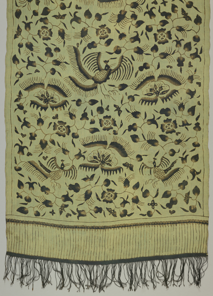 """Textile, probably a breast cloth (kemben) or a shoulder cloth (selendang), with pattern of birds in """"lokcan"""" style (reflecting Chinese influence), insects, leaves, and flowers printed in black and light brown on green ground. Black fringe at either end."""