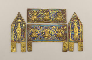 Two horizontal rectangular plaques (a, b) with three cast figural busts attached; one cast figure removed from plaque a.  Two vertical rectangular plaques (c, d) with triangular tops; incised decoration depicting standing robed figure holding book(?).  Holes for attachment to casket-shaped chasse core (e).  Parts a/d) gilt worn; losses to inlaid champleve enamel.