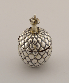 A) egg-shaped bowl and B) cpver from stemmed cup; all-over repousse pineapple pattern.  Bent spikey forms at base and at top where finial with four spiky leaf-like forms joins cover.