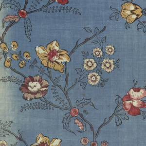 Design of curving branches bearing flowers in three reds, grey, yellow and black on a blue background.