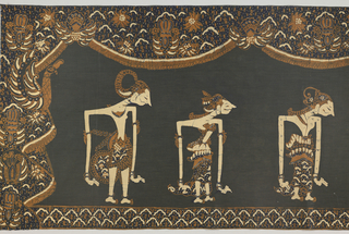 "Oblong cotton panel in black, dark blue, cream-white, and light brown. Shows six ""wayang"" puppets, moving toward center shrine, bearing Rama, a god-like figure. Outer border shows ""ship of the dead"" design and ""lar"" (wing of Garuda, the mount of Vishnu) motif."