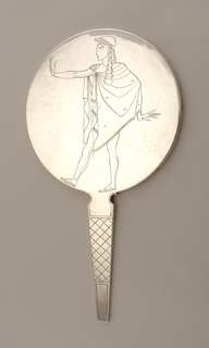 Circular with tapering handle.  Back engraved with stylized, ancient Greek male figure holding mirror in extended hand.  Handle engraved with cross-hatched pattern. (Part of set 1998-21-1/3a,b)