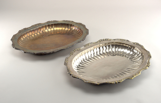 Oval bowls with fluted cavetto. Flat marly with raised edge and a decorated with single and symmetrically opposed acanthus leaves.