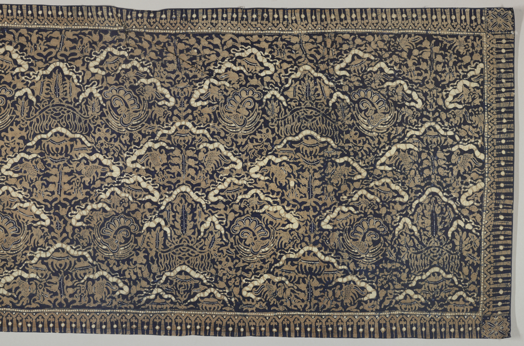 """Batik textile, probably a shoulder cloth (selendang) or breast cloth (kemben) in dark blue, brown, and cream-white. Shows an all-over pattern of the """"ship of the dead"""" motif, stylized and abstracted yet bearing its original meaning."""