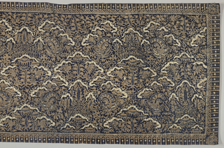 "Batik textile, probably a shoulder cloth (selendang) or breast cloth (kemben) in dark blue, brown, and cream-white. Shows an all-over pattern of the ""ship of the dead"" motif, stylized and abstracted yet bearing its original meaning."
