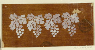 Four vine leaves and bunches of grapes are shown.