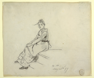 Horizontal view of a young woman seated on a step with her hands clasped over her knees and her head turned to the left, toward sketches.