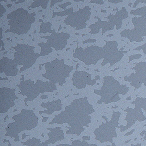 All-over pattern of closely spaced light gray patches on a white ground.