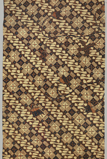 """One of two halves of a long narrow panel cut lengthwise. All-over pattern of two alternating diagonal bands: one made up of alternating dark and light squares and the other a series of curved scroll-like forms and dots (a version of the """"parang"""" or 'knife' motif). Serpentine floral branches are super-imposed on the diagonal pattern. Dyed in deep indigo and rust-red."""