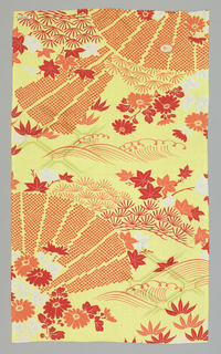 Yellow ground with a woven linear design in light green has a red, orange and white pattern of maple and bamboo leaves with chrysanthemums. Pleated fans shapes have a mock shibori pattern.