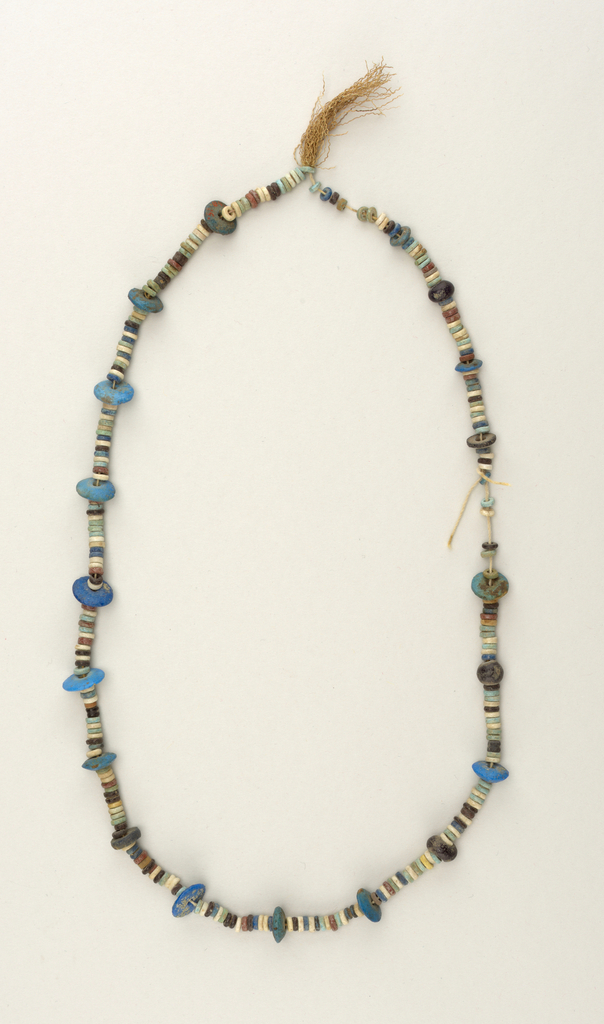 Faience, single strand of disks, multi-colored and sized