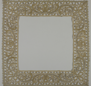 Border for a square, possible a chalice cover, of needle lace – Point d'Espagne. Silk and linen threads in gray and tan, gold and silver thread. Design of symmetrically arranged vine and flowers. Worked in loop and varieties of relief stitches.