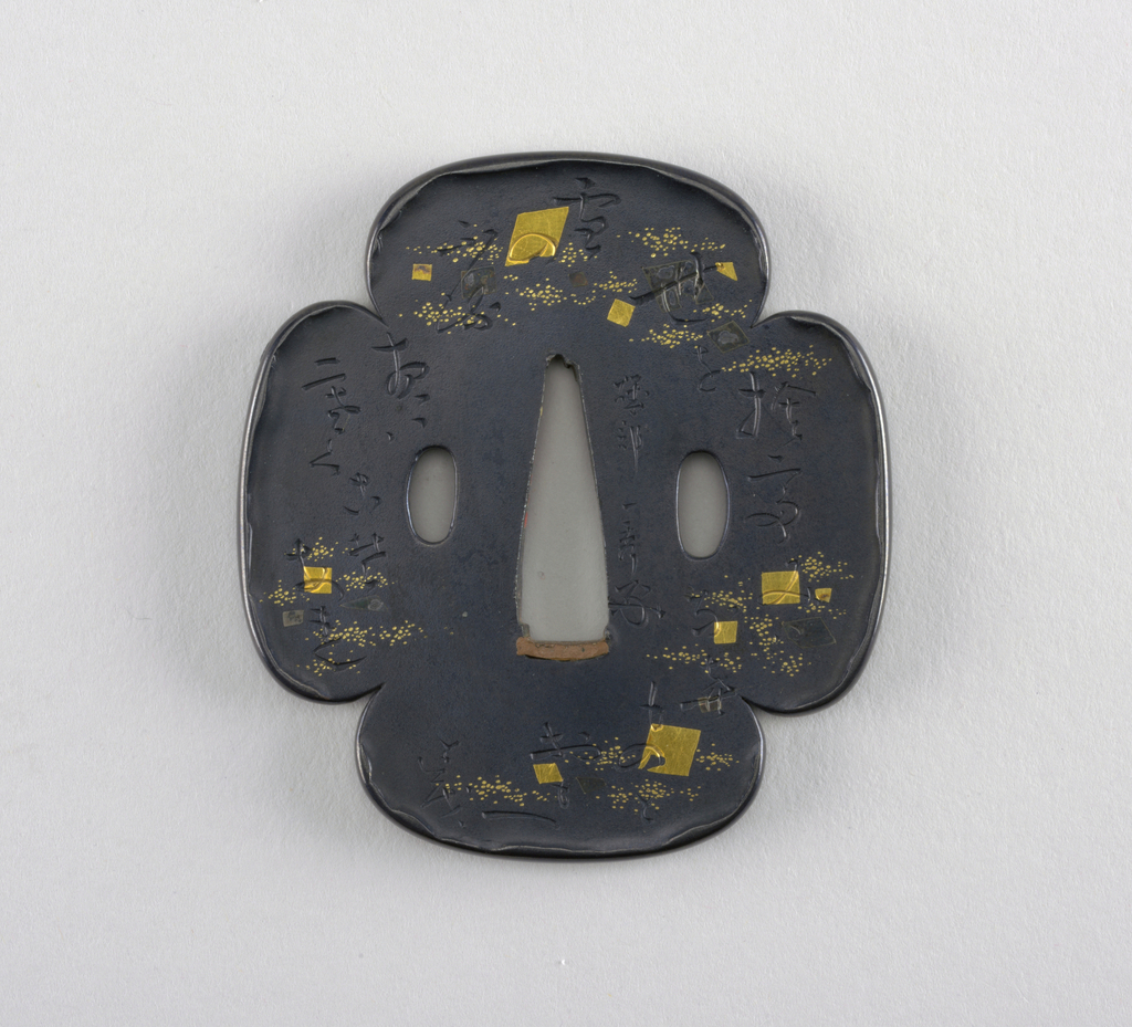 At the center is the nakago-ana, an opening through which the sword passes, with remnants of sekigane (plugs added to fit the tsuba to a sword) made of shakudo (a soft copper and gold alloy). Surrounding this is the seppadai, a flat oval area that is migaki (burnished). On either side are ryō-hitsu, openings for the kozuka (utility knife) and the kogai (skewer tool). Both are hangetsu-kei (half moon) in shape.