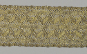 Metallic gold lace in repeated zigzag pattern set in bands and alternating with narrow stripes.
