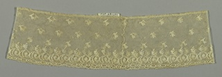Sleeve ruffle of Mechlin lace has the upper part ornamented with buds in diagonal rows. At the border, a row of scrolls with flowers and leaves. Edge is straight.