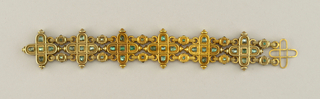 "Heavy gold bracelet with six cruciform motifs and forty-two cabochon emeralds. ""Medieval"" style- continuation of Castellani expanding their repertoire of historical styles."