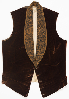 Brown velvet waistcoat with a cotton lining and silk backing. Lapels and collar in brown satin with black floral embroidery.