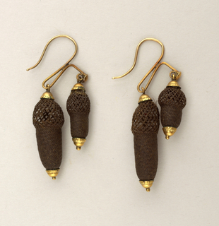 Pair of earrings of hairi-work woven into spherical and cylindrical forms, mounted in gold.