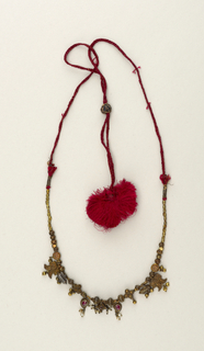 Necklace. Gold beads with semi-precious stones, on red silk cord.