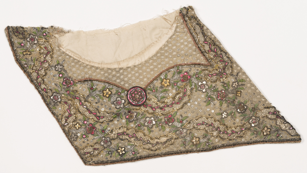 Fragments of a gentleman's waistcoat include two pockets and a portion of the front just above one pocket. Cream-colored silk is heavily embroidered in a floral vine pattern with scrolling leaves made with metallic bobbin lace inserts. Body of the waistcoat has a diamond lattice pattern that encloses flower sprigs.