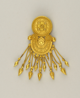Large gold pendant brooch with circular top, arched section below from which hang eleven vase-shaped pendants. Fine gold granulation work throughout.