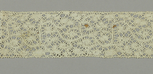 Scroll pattern with brides.