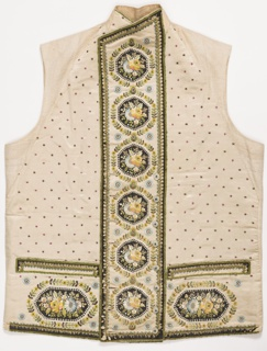 Gentleman's waistcoat with double-breasted closing. Decoration of black silk medallions embroidered in flower sprays at the center front.