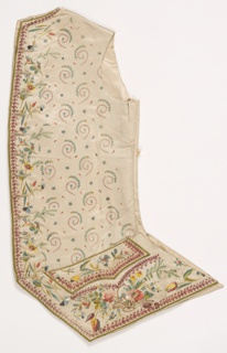 Man's waistcoat of white satin embroidered with multicolored silk thread. Allover design of spiral vines and tiny blossoms. Border design of maroon and green. Pattern of flower sprays down the center front. Basket of flowers under each pocket.