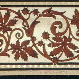 Printed two across, foliate rinceaux, printed in burgundy on gold background.