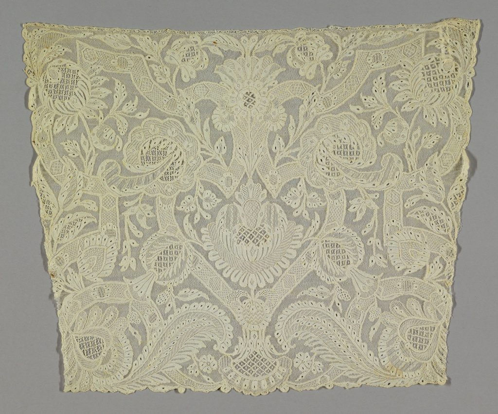 Cravat end with a central heart-shaped motif surrounded by strapwork pattern of bands, floral and foliated forms.