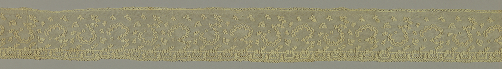 Border with asymmetric floral shapes, freely spaced.