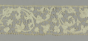 Border of Plat Point de Venise with a swirling floral and foliated branch connected by brides picotées. Toilé showing gaze quadrillée and portes.