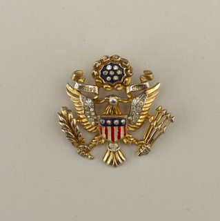 Brooch in form of U.S. seal with eagle.