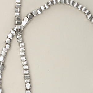Irregular square beads strung on string (replacement).