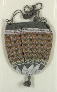 Pouch of finely knitted green cotton with a drawstring at the top and tassel at the bottom. Geometric designs in white beadwork at top and bottom, middle section has vertical stripes of polychrome beads on a brown ground. Lined with doeskin.