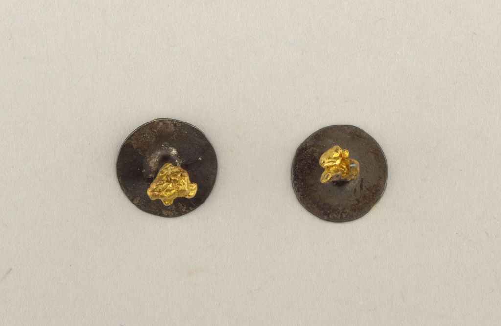Pair of steel studs topped with gold nuggets.
