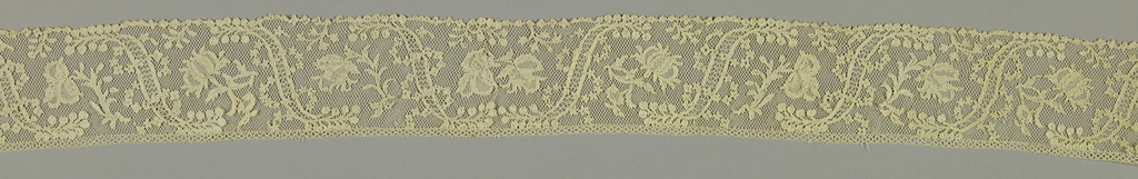 Band with a design of floral sprays alternating with S-shaped bars and entwined by floral garlands.