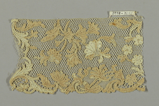 """Edging with scrolls and sprays of flowers and leaves. Commonly called  """"Point d'Argentan"""" with 6 sided mesh."""