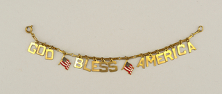 "Gold charm bracelet, spelling ""God Bless America"" with small American flags between each word."