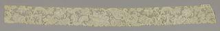 Border of Point de Venise à Réseau with floral and foliated sprays arranged in free flowing asymmetric pattern. Fond: réseau. Modes: portes gaze quadrillée, St. Esprit avec rangs clairs.